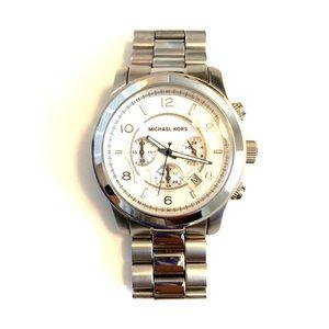 Unisex Michael Kors silver large face watch.